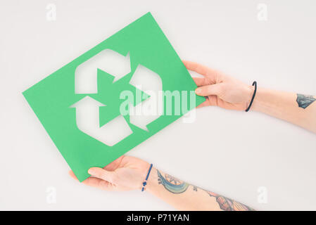 cropped shot of woman holding placard with recycle sign on white - Stock Photo