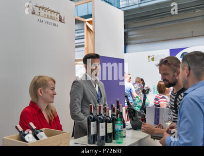 KIEV, UKRAINE - JUNE 02, 2018: Sommeliers presents its red wine Aia Vecchia at Kyiv Wine Festival booth. 77 winemakers from around the world took part - Stock Photo