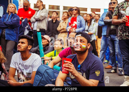ST PETERSBURG, RUSSIA - JULY 3, 2018: fans of football in the fan zone. FIFA World Cup 2018. - Stock Photo