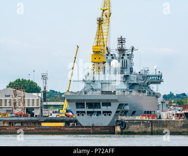 Royal Fleet Auxiliary Wave Knight A389 under refit, Cammell Laird shipyard dock,  Birkenhead, Merseyside, England, UK - Stock Photo