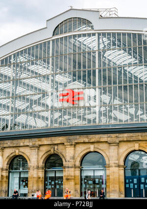 Curved glass roof of Liverpool Lime Street mainline railway station with Network Rail symbol, Liverpool, England, UK - Stock Photo