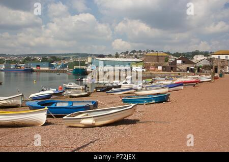 A view of Teignmouth back beach in the summer with fishing boats on the sand - Stock Photo
