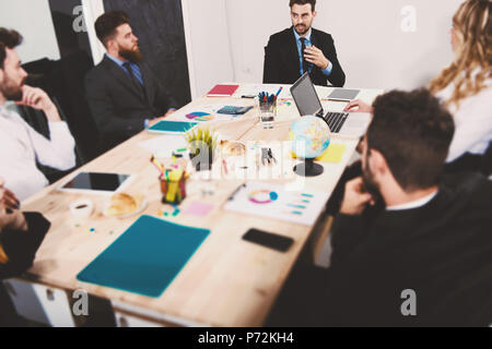 Team of businessmen work together in office. Concept of teamwork and partnership - Stock Photo