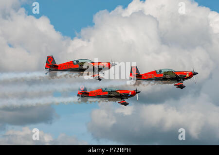 The Blades aerobatic display team taking off from Dunsfold Aerodrome, UK on the 24th August 2014. - Stock Photo
