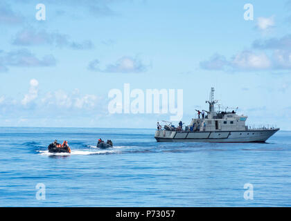 Seychelles Coast Guard boarding team members depart from a simulated target vessel Nov. 13, 2013, off the coast of Port Victoria, Seychelles, during the underway phase of exercise Cutlass Express 2013. Cutlass Express is a U.S. Africa Command-sponsored, Navy-led exercise designed to improve cooperation among participating nations in order to increase maritime safety and security off East Africa. (DoD - Stock Photo