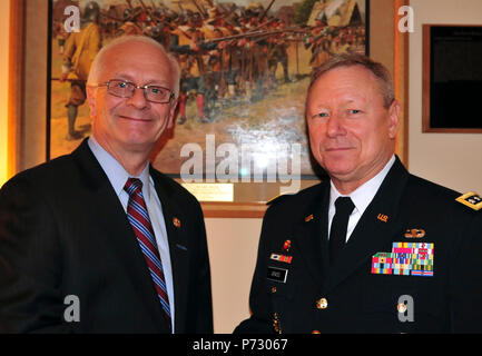 Army Gen. Frank Grass, the chief of the National Guard Bureau, meets with U.S. Rep. Kerry Bentivolio, Mich., at a reception Nov. 20, 2013. (Army National Guard - Stock Photo