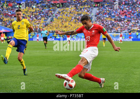 St. Petersburg, Russland. 03rd July, 2018. Ricardo RODRIGUEZ (SUI), action, duels versus Mikael FUNNY (SWE). Sweden (SWE) - Switzerland (SUI) 1-0, Round of 16, Round of 16, Game 55, on 07/03/2018 in Saint Petersburg, Arena Saint Petersburg. Football World Cup 2018 in Russia from 14.06. - 15.07.2018. | usage worldwide Credit: dpa/Alamy Live News - Stock Photo