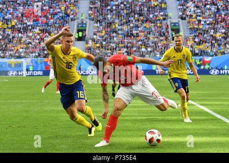St. Petersburg, Russland. 03rd July, 2018. Ricardo RODRIGUEZ (SUI), action, duels versus Emil KRAFTH (SWE). Sweden (SWE) - Switzerland (SUI) 1-0, Round of 16, Round of 16, Game 55, on 07/03/2018 in Saint Petersburg, Arena Saint Petersburg. Football World Cup 2018 in Russia from 14.06. - 15.07.2018. | usage worldwide Credit: dpa/Alamy Live News - Stock Photo