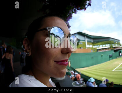 4th July 2018, All England Lawn Tennis and Croquet Club, London, England; The Wimbledon Tennis Championships, Day 3; Female spectator observing the Championship courts wearing Ray Bans - Stock Photo