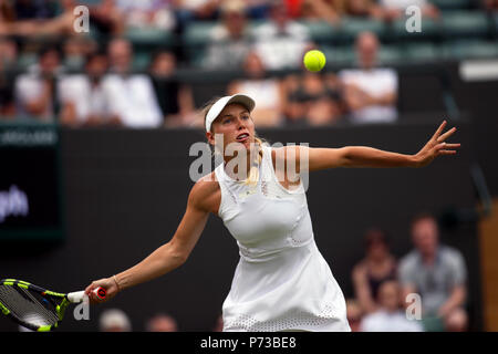 London, England - July 4th, 2018.  Wimbledon Tennis:  Number 2 seed Caroline Wozniacki of Denmark during her match against Ekaterina Makarova in the second round at Wimbledon today. Credit: Adam Stoltman/Alamy Live News - Stock Photo