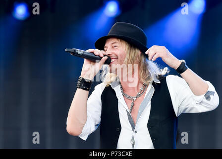 Prague, Czech Republic. 04th July, 2018. The Swiss rock group Gotthard (pictured singer NIC MAEDER) is the support band of the Rolling Stones legendary rock band. Rolling Stones will play at Prague's Letnany airfield, Czech Republic, tonight July 4, 2018, within their No Filter tour on a stage that is 32 metres high and nearly 80 metres long. The organisers expect approximately 50,000 people to come to see Mick Jagger, Keith Richards, Charlie Watts and Ronnie Wood play. Credit: Vit Simanek/CTK Photo/Alamy Live News - Stock Photo