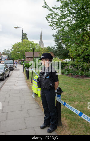 Amesbury, United Kingdom. 4th July 2018. PICTURED: Queen Elizabeth Gardens in Salisbury is cordoned off by police. Wiltshire Police and partners have declared a major incident after it is suspected that two people might have been exposed to an unknown substance in Amesbury. Emergency services were called to an address in Muggleton Road, Amesbury on Saturday evening (30th June 2018) after a man and woman, both in their 40s, were found unconscious in a property. Credit: Peter Manning/Alamy Live News - Stock Photo