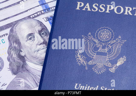 USA Passport with Cash Money Isolated on a White Background. - Stock Photo