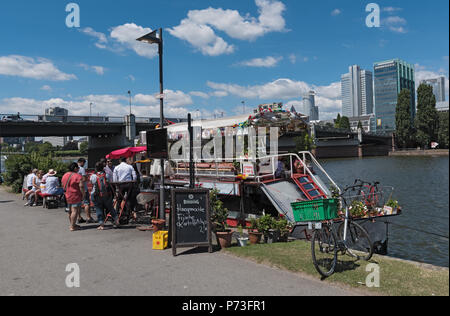 customers in front of the Floating Food stall on the Main River, Frankfurt, Germany