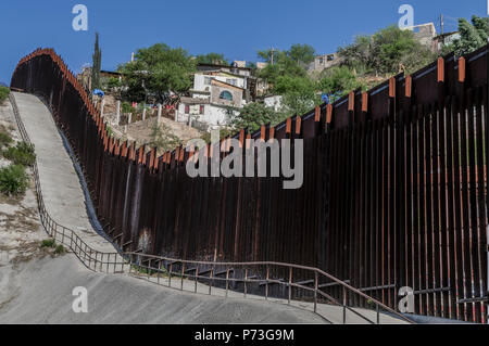 United States Border Fence, viewed from US side showing Nogales Mexico., looking east from near port of entry in downtown Nogales AZ, April 12, 2018 - Stock Photo