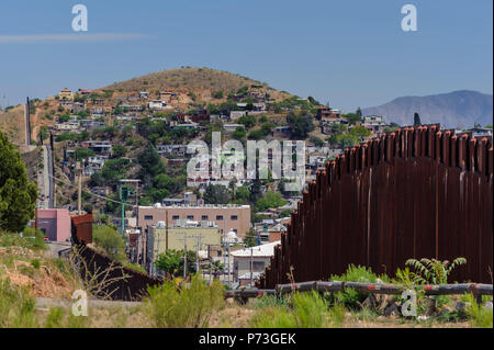 United States Border Fence, pedestrian barrier, looking east from US side, showing Nogales Sonora Mexico on hillside.  April 12, 2018 - Stock Photo