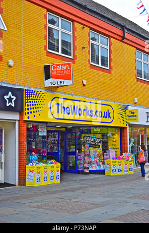 The modern shop unit in the town centre occupied by The Works, selling toys, books games and stationery. - Stock Photo