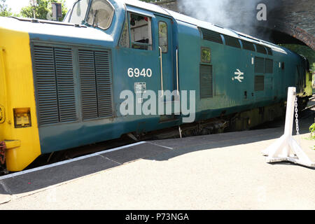 July 03 2018 - Carrog railway station,Wales, UK. with a Class 37 Locomotive group (C37LG) English Electric Type 3. V12 Engine 1700bhp. - Stock Photo