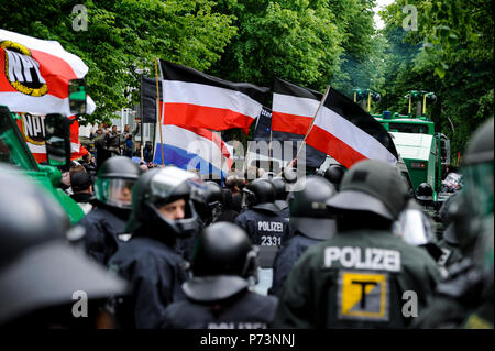 Germany, rally of Nazi and right extremists groups with flags of right wing party NPD in hamburg, escorted by police forces to avoid clashes with left-wing anti-protesters - Stock Photo
