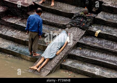 Cremation at Pasthupatinah Temple, Kathmandu - Stock Photo