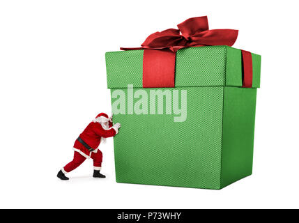 Santa Claus pushing huge gift box full of presents isolated on white background - Stock Photo