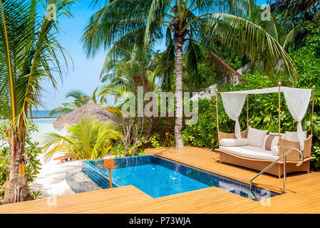 Take a pause. Maldives beautiful beach background white sandy tropical paradise island with blue sky sea water ocean - Stock Photo