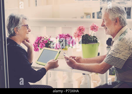 senior happy caucasian couple in outdoor leisure activity using technology ti chat work and do videoconference with friends. lifestyle at home in mode - Stock Photo