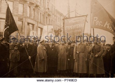 Bolshevik leaders in front of a procession for the 1st of May, 1920. In the center, one recognizes Grigori Zinoviev with an Astrakhan. The central banner reads: 'Committee of the Petrograd Province'. Petrograd, Saint Petersburg, Russia, History of the Russian Revolution. - Stock Photo
