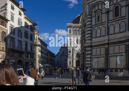 FLORENCE, ITALY - NOVEMBER 22 2015: People in Duomo's square in Florence, Italy - Stock Photo
