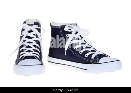 Pair of womens high top lace up dark navy blue sneakers isolated on white background - Stock Photo
