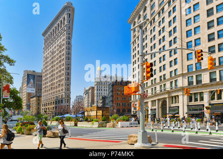 New York, USA- September 05, 2017 : Flatiron Building on 5th Avenue near Madison Square Park. Urban views of New York. Street, people and tourists on  - Stock Photo