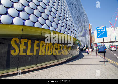 Birmingham, UK: June 29, 2018: Selfridges Department Store in Park Street - part of the Bullring Shopping Centre. Pedestrians walk toward the bus stop - Stock Photo