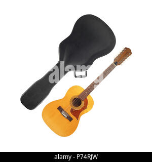 Musical instrument - Vintage twelve-string acoustic guitar hard case on a white background. Stock Photo