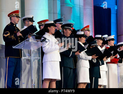 WASHINGTON, D.C. (June 15, 2014) Members of the U.S. Navy Band Sea Chanters participate as part of the Joint Armed Forces Chorus to commemorate Arlington National Cemetery's 150th Anniversary.  Arlington National Cemetery presented a musical and historical tribute to their past present and future featuring remarks by Secretary of the Army, the Honorable John McHugh and music by the Joint Armed Forces Chorus and 'The President's Own,' U.S. Marine Band. - Stock Photo
