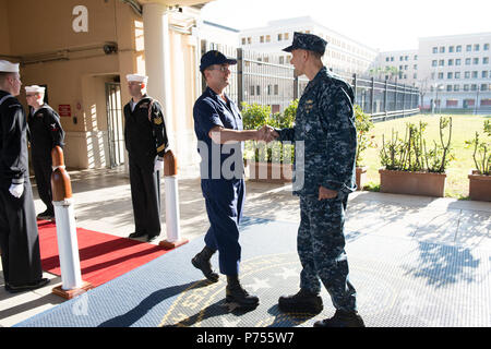 NAVAL SUPPORT ACTIVITY NAPLES, Italy (Dec. 17, 2015)  U.S. Naval Forces Europe-Africa Chief of Staff, Rear Adm. Cathal O'Connor, right, welcomes Vice Commandant, U.S. Coast Guard, Vice. Adm. Charles Michel, to U.S. 6th Fleet Headquarters, Dec. 17, 2015. U.S. 6th Fleet, headquartered in Naples, Italy, conducts the full spectrum of joint and naval operations, often in concert with allied, joint, and interagency partner, in order to advance U.S. national interests and security and stability in Europe and Africa. - Stock Photo