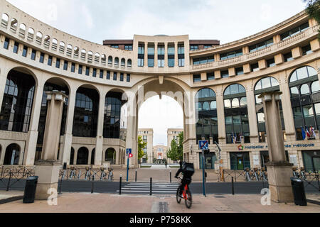 Montpellier, France. The Montpellier Mediterranee Metropole, one of the buildings of the Quartier Antigone, in the Place du Millenaire - Stock Photo