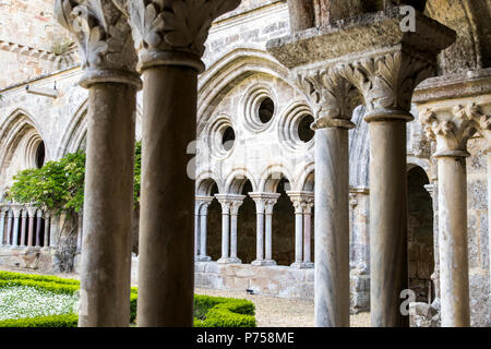 Interior view of the cloister of the Abbaye de Fontfroide, a former Cistercian monastery and abbey in Southern France - Stock Photo