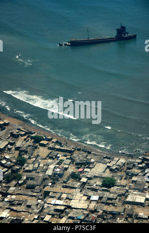 Aerial View of a Ship Wreckage off the Shore of Ghana - Stock Photo