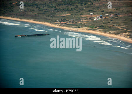 Aerial View of a disassembled Ship Wreckage off the Coast of Ghana - Stock Photo