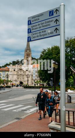 Burgos, Spain - June 13, 2018: Pilgrims on the Camino de Santiago Way of St. James in the historic city centre fo Burgos, Spain. Selective focus on si - Stock Photo