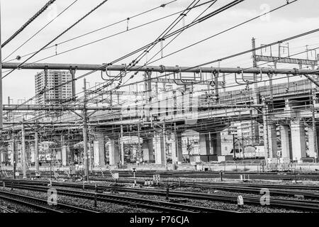 A mass of overhead electricity wires at a train station, Omiya, Japan - Stock Photo