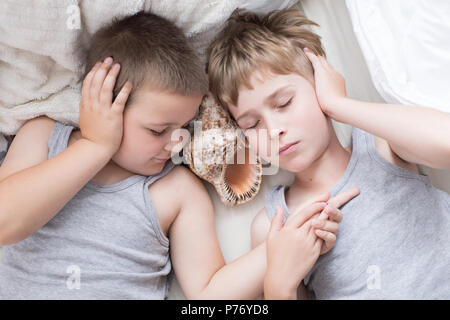 Brothers - a lazy morning in bed, bedding. Fun and rest, relax, lazy Sunday - Stock Photo