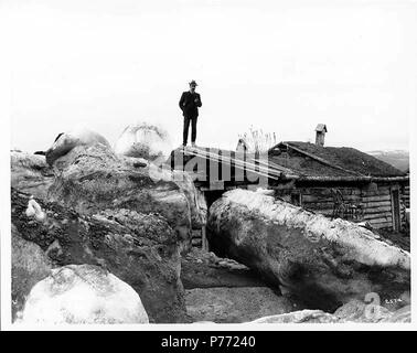 . English: Blocks of ice from ice jam beside log cabin, Fortymile, ca. 1904 . English: Caption on image: 2524 On verso of image: Ice jam at 40 Mile. Huge ice blocks driven up bank to cabins. Fortymile is located at the junction of Bullion Creek and North Fork Fortymile River, 37 miles southwest of Eagle, Yukon-Tanana Highway. It is a former telegraph station established in 1903 by the U.S. Army Signal Corps and originally called North Fork after the stream. The prospectors called it Fortymile. Subjects (LCTGM): Ice--Alaska--Fortymile; Log cabins--Alaska--Fortymile  . circa 1904 2 Blocks of ice - Stock Photo