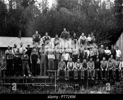 . English: Crew posing by camp office, Columbia River Timber Company, Skamokawa, ca. 1918 . English: The Columbia River Timber Company had headquarters in Portland, Oregon, and camps at Goble, Oregon, Skamokawa and Yacolt, Washington. Caption on image: Columbia River Timber + Logging Co., Skamokawa, Ore, No. 6 PH Coll 516.708 The Columbia River Timber Company operated in the early twentieth century in the Columbia River basin area with camps in Goble of Columbia County, Yacolt of Clark County, and Skamokawa of Wahkiakum County. Goble was a stop on the Goble, Nehalem & Pacific Railway. Subjects - Stock Photo