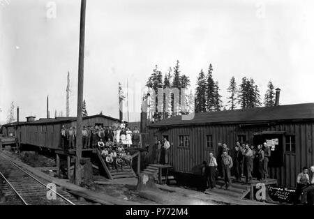 . English: Crew posing at railroad camp near office, Columbia River Timber Company, ca. 1918 . English: The Columbia River Timber Company had headquarters in Portland, Oregon, and camps at Goble, Oregon, Skamokawa and Yacolt, Washington. Caption on image: Columbia River Co., No. 232 PH Coll 516.713 The Columbia River Timber Company operated in the early twentieth century in the Columbia River basin area with camps in Goble of Columbia County, Yacolt of Clark County, and Skamokawa of Wahkiakum County. Goble was a stop on the Goble, Nehalem & Pacific Railway. Subjects (LCSH): xyz  . circa 1918 3 - Stock Photo