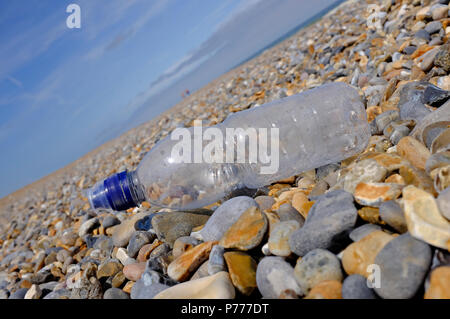 plastic bottle on shingle beach, cley, north norfolk, england - Stock Photo