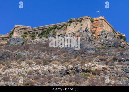 The ruins of ancient Venetian fortress on the island Imeri Gramvousa. Mediterranean Sea. Crete, Greece - Stock Photo