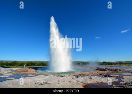Strokkur Geyser In Iceland Mid-eruption - Stock Photo