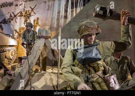 Diorama showing WW2 US soldiers fighting at Omaha beach in the Overlord Museum about WWII D-Day, Colleville-sur-Mer, Normandy, France - Stock Photo