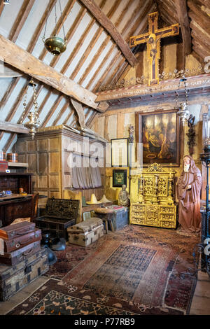 Charles Wades bedroom in the Priests House at Snowshill Manor in the Cotswold village of Snowshill, Gloucestershire UK - Stock Photo